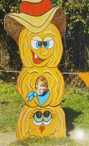 Take a picture with a pumpkin poster at Summers' fall festival