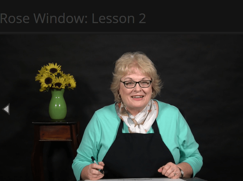 Ms. Sharon in a video lesson on Creating a Masterpiece